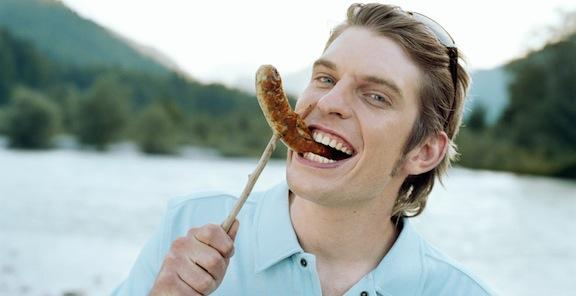 man eating sausage